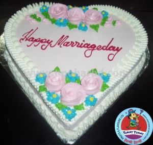 Heart shape cake with lots of flowers