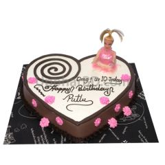 Heart shape birthday cake with doll