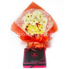 Surprise gift with elit gourmet and flowers
