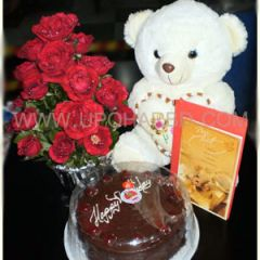 Chocolate cake with teddy bear and flower bouquet