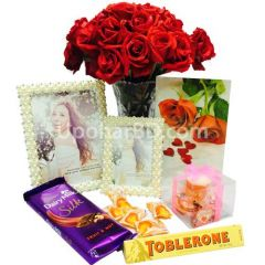 Red roses, chocolate and photo frames