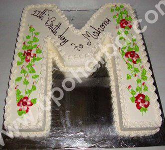 single letter shape cake with garden design