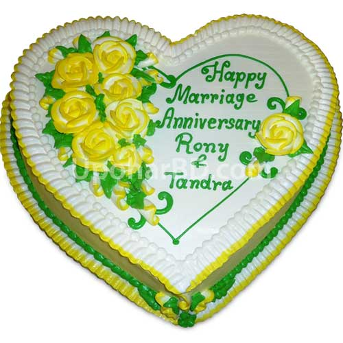 Heart shape cake with green and gold