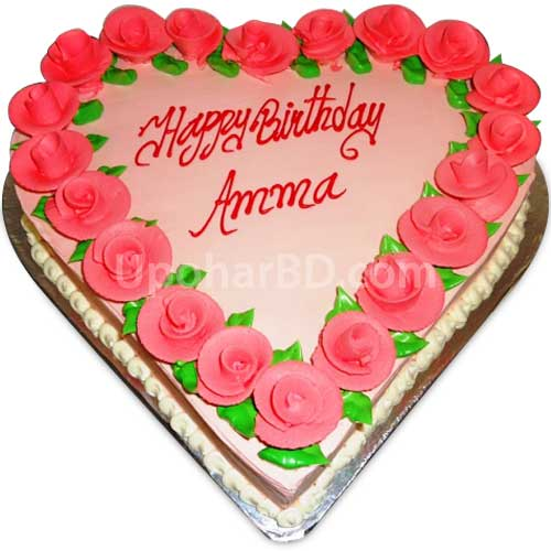 Heart shape cake with pink design and pink roses