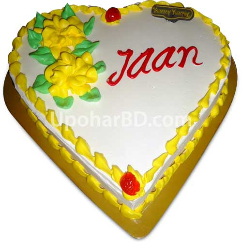 Heart shape cake with large yellow roses