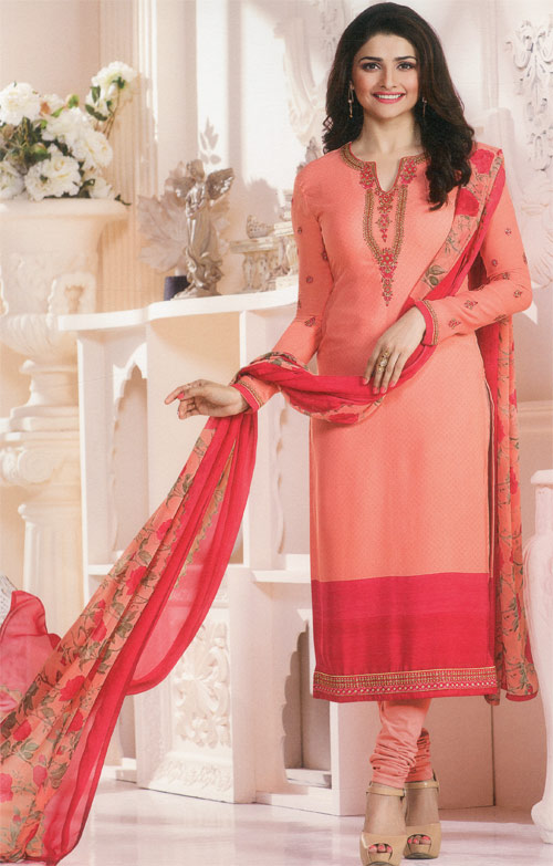Orange salmon exclusive fancy party suit by Vinay fashion