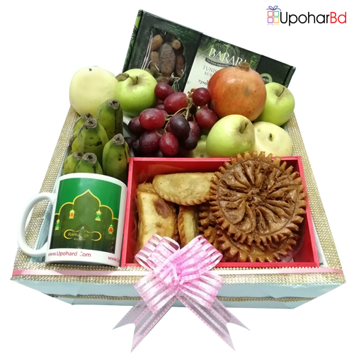 Delicious pithas and fruits gift box