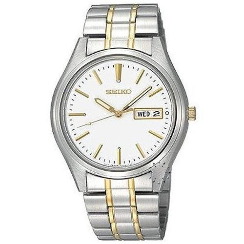 Silver colour Seiko wrist watch with round dial