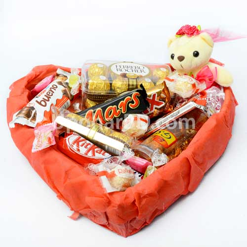Package of assorted chocolates and teddy