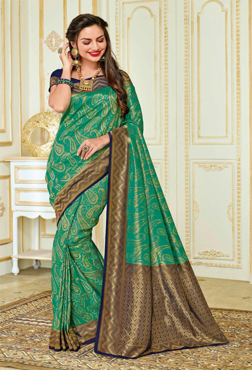 Gorgeous Turquoise green and blue-cooper sardine with blue border contrast Saree from rajguru catalog.