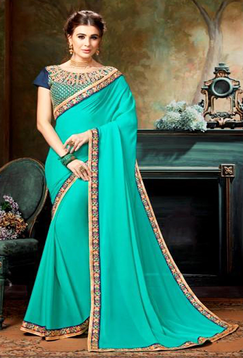 Gorgeous Turquoise Blue color with heavy border embroidery work party wear