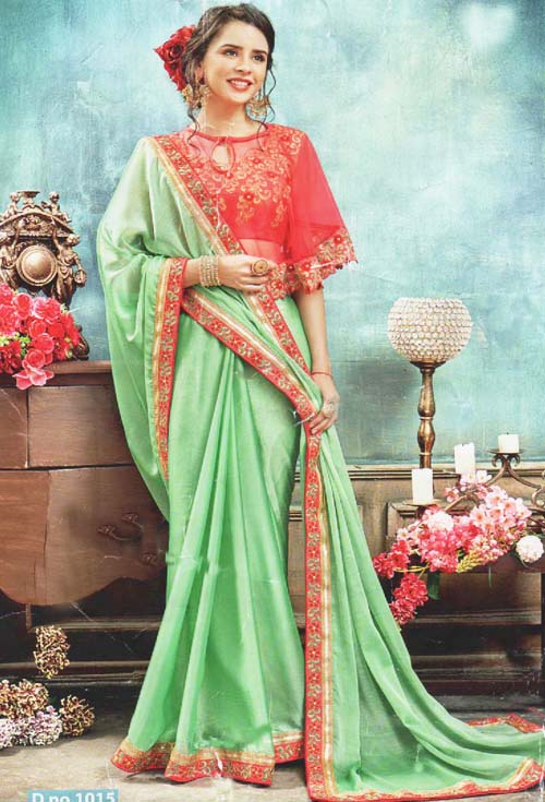 Sweet Spring Green color with heavy border embroidery work party wear