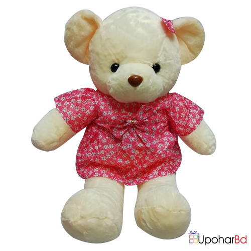 Cream color teddy with pink bow