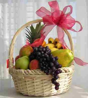 Fruit basket with papaya and grapes