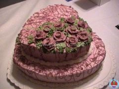 Duel layer heart shape cake with lots of flower