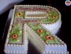 Single letter shape cake with Garden design