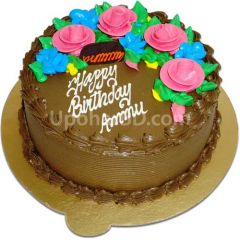 Cake with rich chocolate and pink roses
