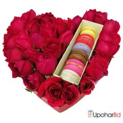 Heart shaped gift box with roses and macaroon