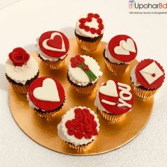 9 cupcakes with red and white hearts
