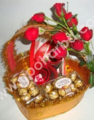 Gift package with chocolates and rose