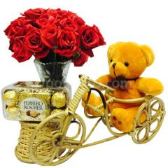 Teddy on rickshaw with chocolate and flower