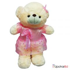 Cream teddy bear with fancy dress