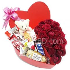 Heart shaped gift box with roses and chocolate